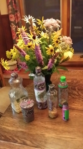 Tansy,Liatrus,Day Lilies and Black Eyed Susan with pressed flowers and recycled bottle shakers.